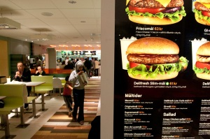 Swedes at a local burger joint, where the menus lists CO2 emissions as well as the caloric and other nutritional values of their meals.